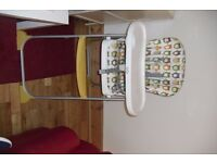 HIGHCHAIR IN GOOD CONDITION IT RECLINES + FOLDS FOR EASY STORAGE