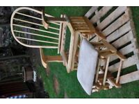 wooden rocking chair with foot stool, it is a self assy. easy to assmble but no soft covers