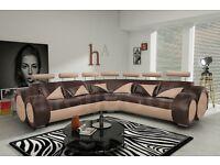 Lovely large brown and beige leather corner sofa.Superb modern design. 1 month old. can deliver