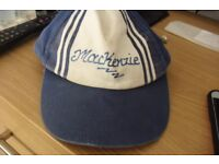 BLUE/WHITE SUN CAP WITH THE PERSONALISED NAME MACKENZIE WRITTEN ON THE FRONT
