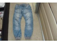 "SIZE 32R PAIR MEN'S ""CROSSHATCH"" JEANS WITH CUFFS AT THE BOTTOM"
