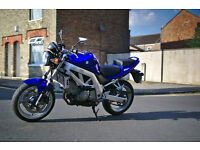 Low-mileage and well maintained blue Suzuki SV 650 naked (2004)
