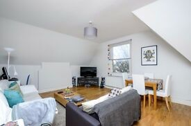 Spacious modern property within a handsome freehold house a short walk to tube and rail links -BH