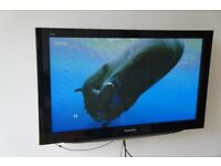 Panasonic Viera Plasma TV TH-46PZ85B, including swing arm wall mount and table base