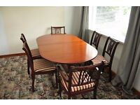 large extendable dining table & six chairs