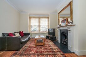 Spread over three floors is this end of terrace four double bedroom family home to rent in Putney