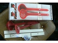 Tupperware ladle/ slotted serving spoon.