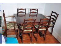 solid dark wooden dining table with 6 chairs