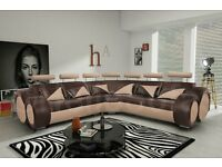 Fantastic large brown and beige leather corner sofa.Superb modern design. 1 month old. can deliver
