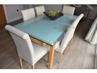 Extending Glass Top Dinning table with 6 chairs