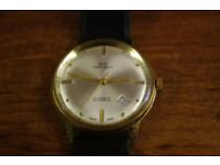 vintage arpeggio 21 jewel automatic gold colored case with champagne dial leather strap working