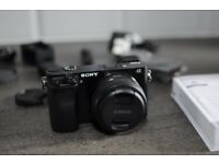 Sony Alpha A6000 mirrorless camera, boxed with 20mm f/2.8 lens and accessories