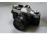 canon ae1 35mm slr analog film camera 24mm wide angle lens