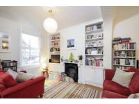 A BEAUTIFULLY PRESENTED TWO DOUBLE BEDROOM COTTAGE WITH PRIVATE GARDEN ON LATCHMERE ROAD, BATTERSEA