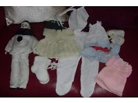 COLLECTION OF DOLLS CLOTHES + POT CLOWN DOLL