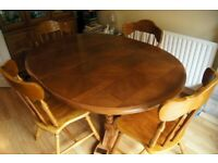 Extendable Dining Table, 4 Matching Chairs, plus 1 Additional Pine Chair