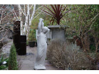 Maiden statue carrying jug
