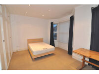 An amazing double room in a clean and tidy house in Barons Court, NO DEPOSIT REQ., ALL BILLS INCL.