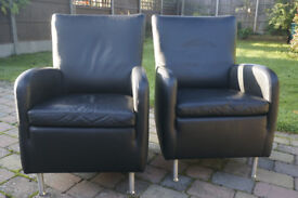 2 black leather armchairs for sale.