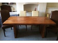 Hardwood Dining Table with 4 Cream Leather chairs and 2 Brown Leather chairs