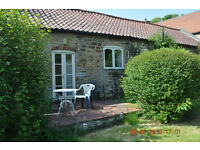 Nicely furnished cottage to let for flexible short term. Includes council tax and is per week.
