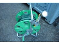 Hoselock hose on reel with spray attachment