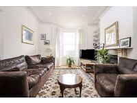 A LARGE FOUR BEDROOM HOUSE WITH PRIVATE GARDEN SITUATED ON BURLAND ROAD, MOMENTS FROM NORTHCOTE ROAD