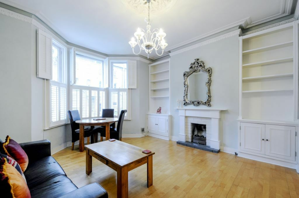 Two double bedroom, offering a bright reception room and fitted kitchen on Edith Road, W14