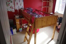Childs solid pine bed frame with sliding desk. Bed has small ladder for access to bed.