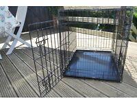 Black metal folding med-large dog crate