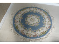 Rug, circular, Chinese style, in wool with raised pattern in pale blue and cream.