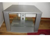 "GREY TV STAND WITH GLASS SHELF IN THE MIDDLE HEIGHT 19"" LENGTH 27"""
