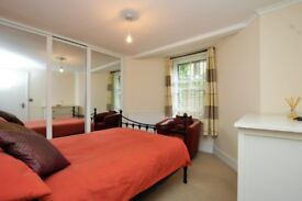 Spacious one bedroom ground floor flat set with its own entrance on this quiet residential street,