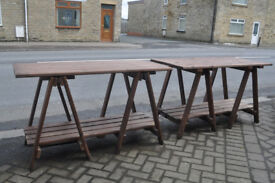pair of large wooden trestle tables