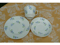 Vintage china cup, saucer and tea plate in pretty hand painted forget-me-not pattern.