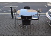 granite barker and stonehouse table and four chairs