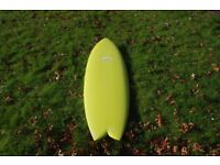 Advance epoxy twin fin surfboard.