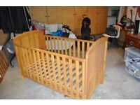 Babies ,toddlers cot in excellent condition with Winnie the pooh logo on end panel