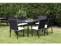 Brand new!!! Boxed!!!7 piece rattan garden set. Includes glass table and 6 chairs with cushions