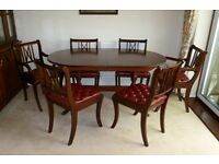 Mahogany Dining Room Suite, 6 red leather padded seats, table extends.