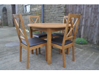 Oak Veneer Round Dining Table And Four Chairs
