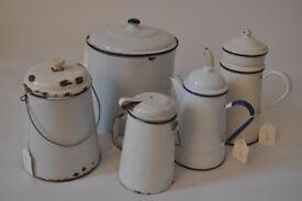 an array of vintage enamel pots