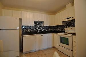 Luxurious 2 bed+den w. laminate, in-suite laundry and parking!