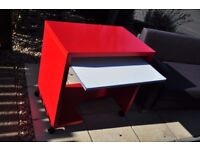 Red wooden IKEA desk and pink office chair