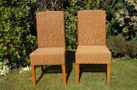 Pair of rattan chairs ideal as conservatory or bistro chairs.