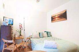 Outstanding studio with patio on Fairholme Road, West Kensington, £285 pw