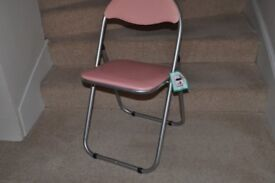 Pretty pink and silver folding chair. Suit all ages.