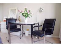 GLASS TABLE AND 2 COMFORTABLE LEATHER CHAIRS