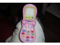 """PEPPA PIG"" LITTLE TOY MOBILE PHONE WITH VARIOUS THINGS TO DO ON IT"