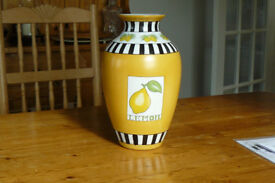 "Vase, lemon coloured china, 12"" high with lemon and leaf motif."